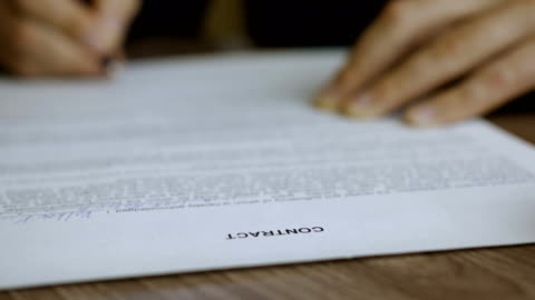 Businessman signing business contract agreement, close up of male hand with pen writing signature. The man corrects and fills the document. Businessman signing business contract agreement, close up of male hand with pen writing signature. The man corrects and fills the document. agreement stock videos & royalty-free footage