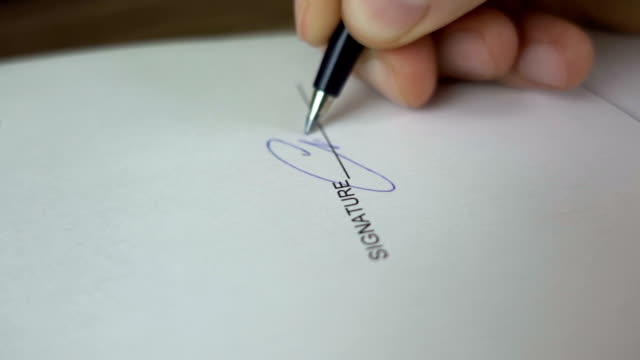 businessman signing business contract agreement, close up of male hand with pen writing signature - firma video stock e b–roll