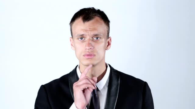 Businessman silent quiet gesture with finger video