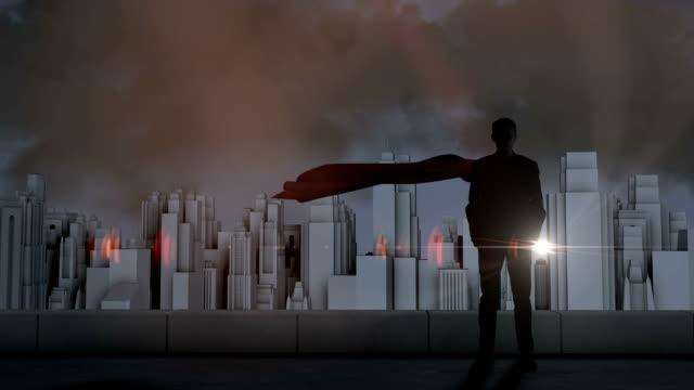 vídeos de stock e filmes b-roll de businessman silhouette with flash lightning and storm on cityscape background - super hero