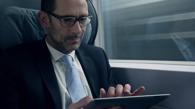 Businessman sitting and working in train video