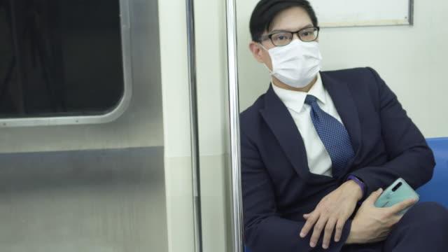 Businessman sleep in subway train and wake up