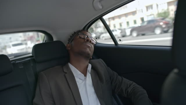 Businessman Sleeping During Car Ride video