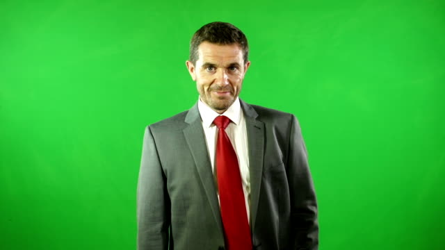 Businessman smiling in front of Green Screen video