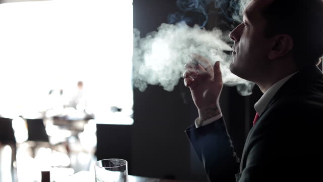 Businessman smoking cigar video