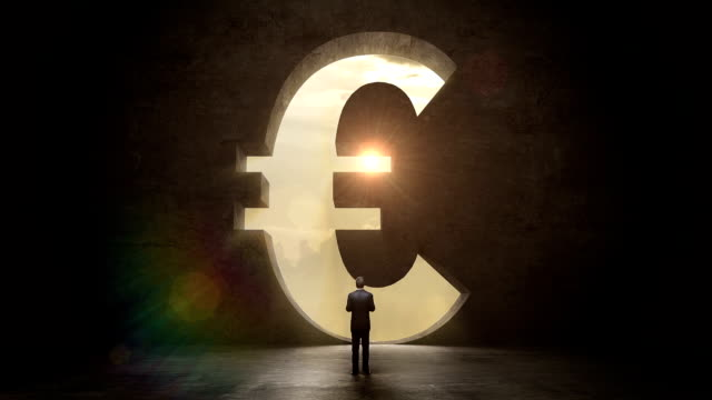 businessman standing black wall, shape of euro currency.economic diagram video