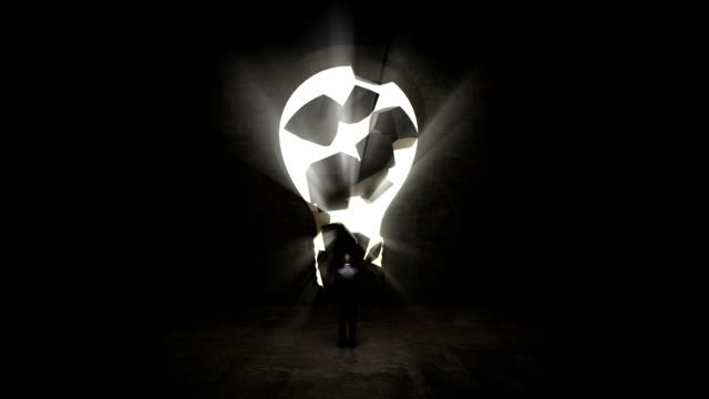 businessman standing in front of black, shape of bulb light. - idea stock videos & royalty-free footage