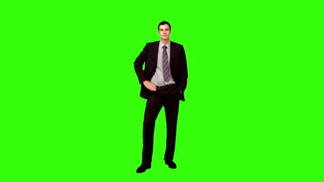 stockvideo's en b-roll-footage met businessman standing with hand on hip - handen op de heupen