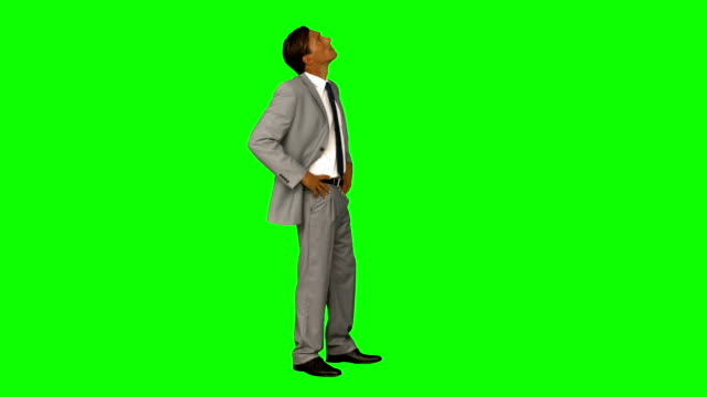 Businessman standing with hands on hips Businessman standing with hands on hips on green screen background arms akimbo stock videos & royalty-free footage
