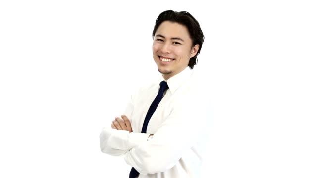 ビジネスマンに立つ彼は両腕をクロスのシャツを合わせて - オペレーター 日本人点の映像素材/bロール
