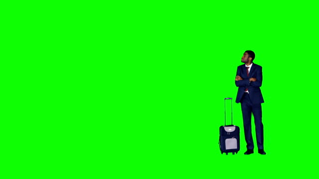 Businessman standing with suitcase video