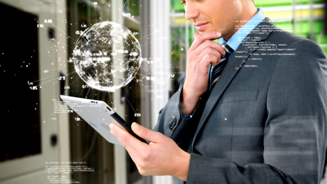 Businessman studying on his tablet