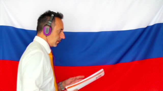 Businessman studying russian language video