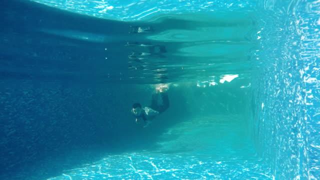 Businessman swims under water video