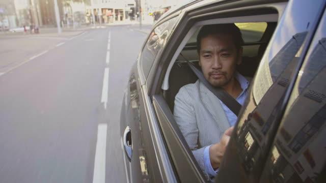 Businessman takes a taxi ride through the city video