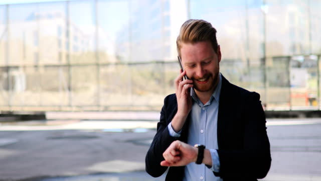 Businessman talking on the phone video