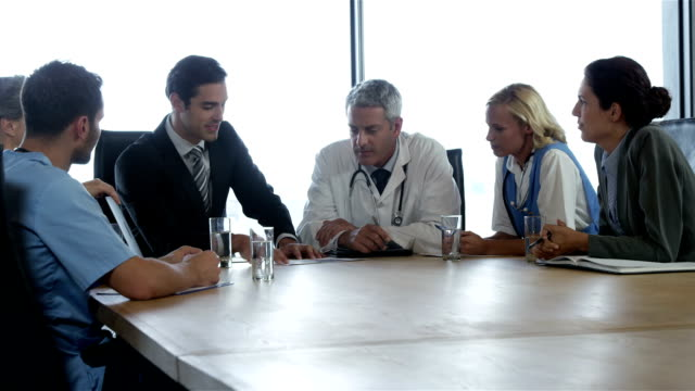 Businessman talking to a medical team video