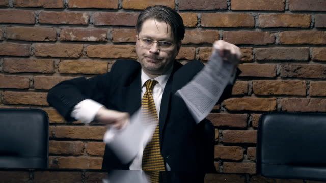 Businessman tearing a contract in pieces video