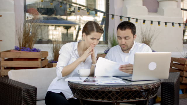Businessman tearing up a document, contract or agreement on business meeting in cafe video