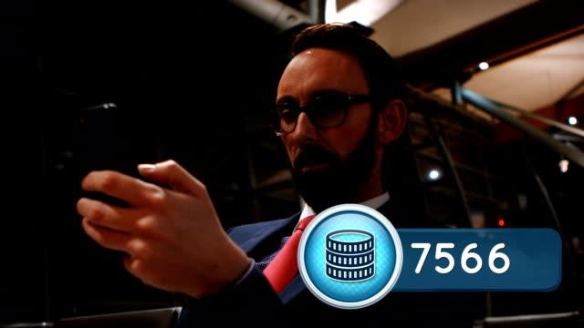 Businessman texting inside a terminal