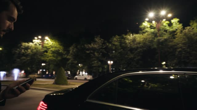 Businessman traveling. Business person traveling late in night. luxury car stock videos & royalty-free footage
