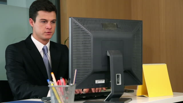 Businessman trying to destress at work video