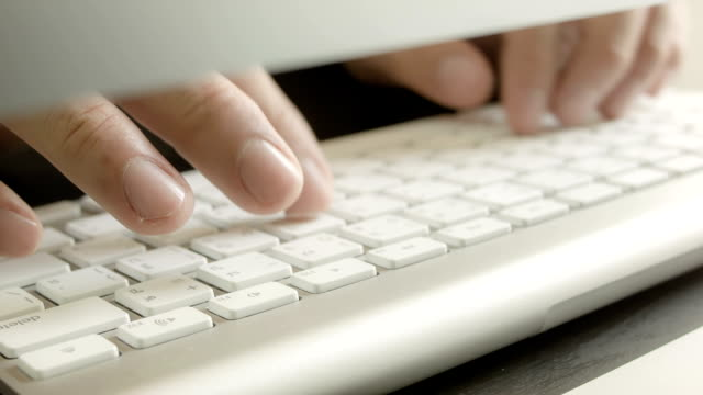 Businessman typing on a computer keyboard video
