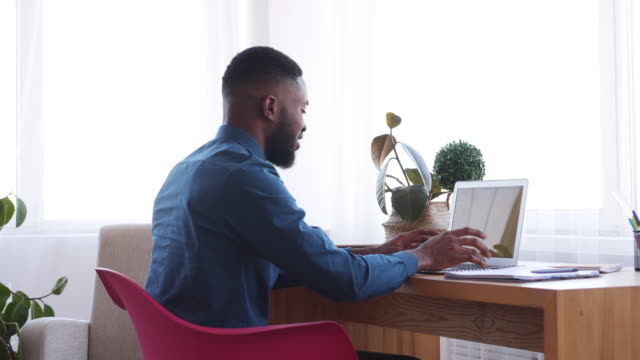 Businessman typing on laptop at office video