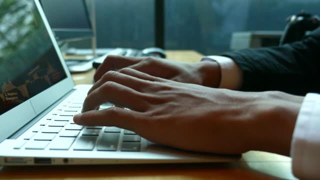 Businessman typing on Laptop Keyboard, Dolly shot video