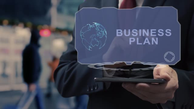 Businessman uses hologram Business plan