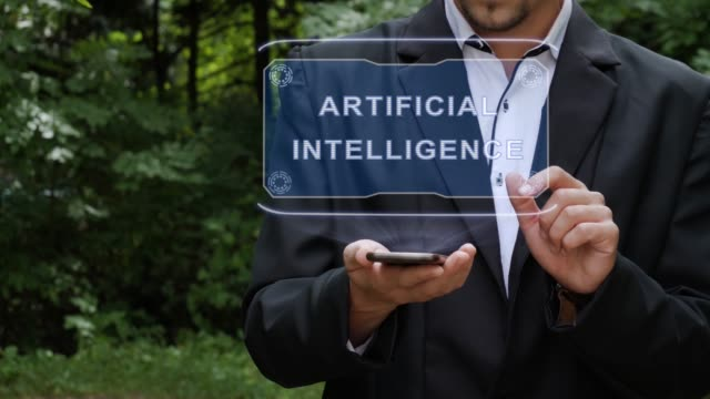 Businessman uses hologram with text Artificial Intelligence