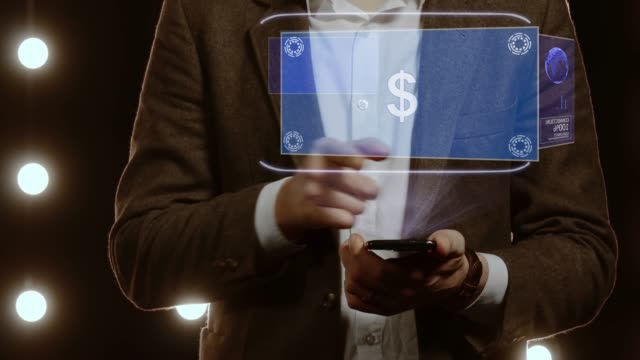 Businessman uses hologram with text Sign USD