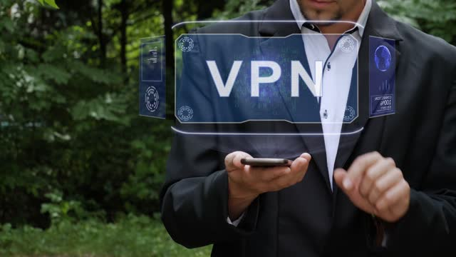 Businessman uses hologram with text VPN