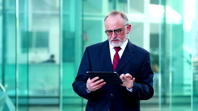 Businessman using a digital tablet, HD movie (1920X1080, 25 fps) video