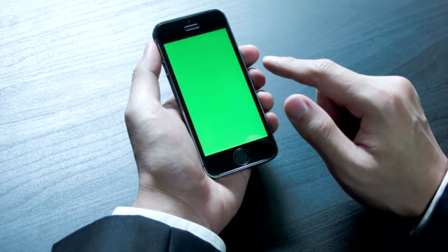 Businessman using a Smart phone Touchscreen Chroma key. video
