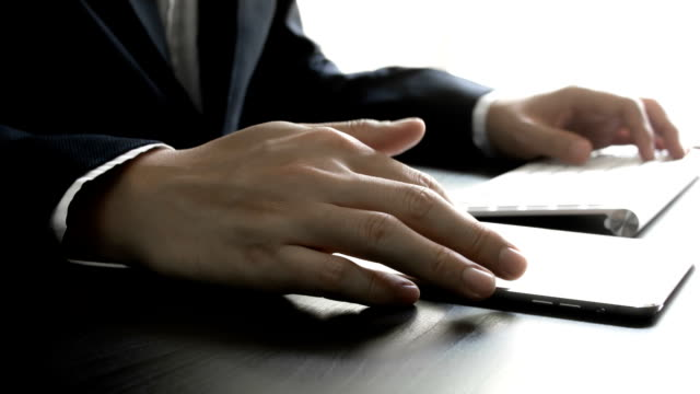 Businessman using a tablet computer video