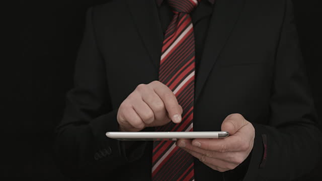 Businessman Using A White Tablet To Check Messages video