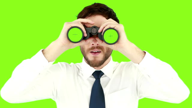 Businessman using binoculars video