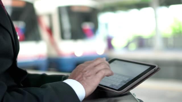 Businessman using digital tablet at train platform Business activity subway platform stock videos & royalty-free footage