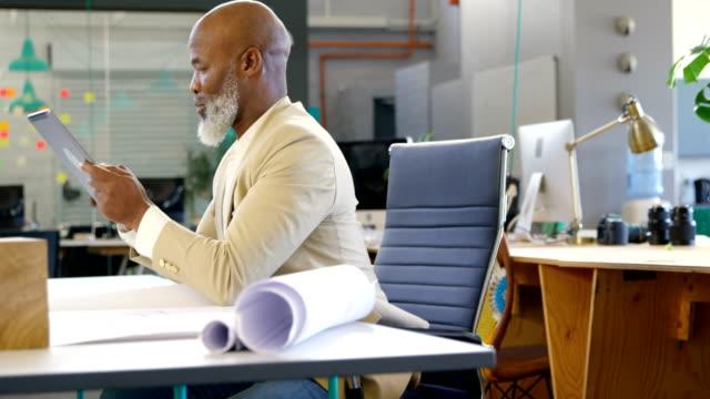 Businessman using digital tablet in the office 4k video