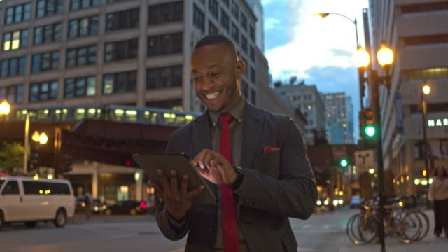 Businessman using digital tablet on the streets of Chicago video