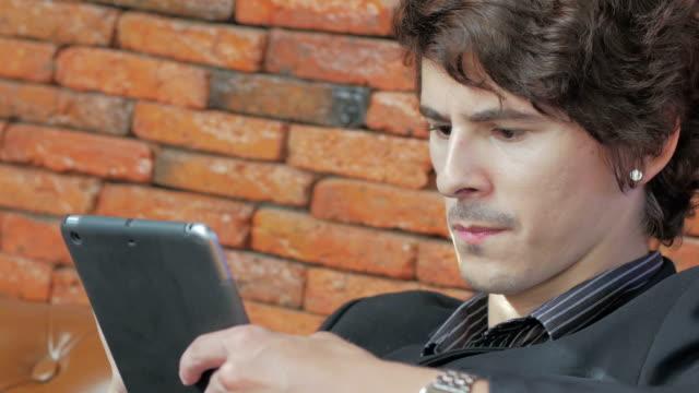 Businessman using digital tablet video