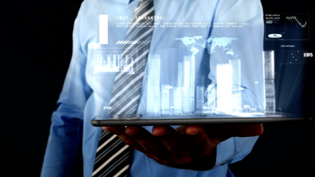Businessman using digital tablet with binary interface projecting information a