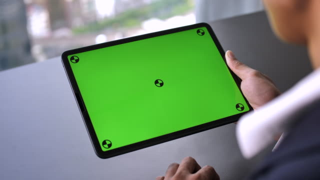businessman using digital tablet with green screen, horizontal - ipad video stock e b–roll