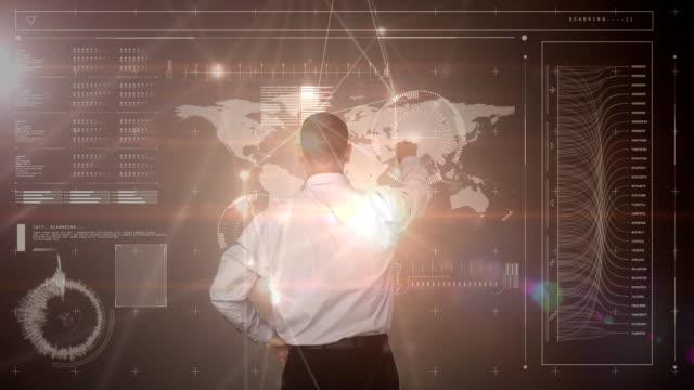 Businessman using futuristic screen