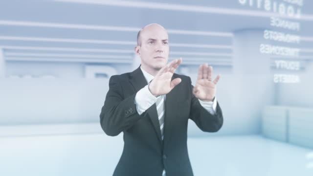 HD: Businessman Using Futuristic Visual Screen video