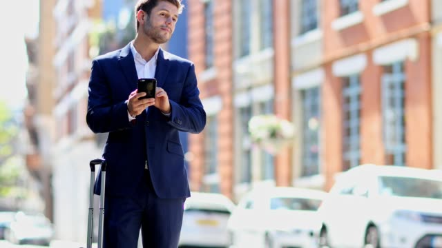 Businessman Using Mobile Phone App To Order Taxi
