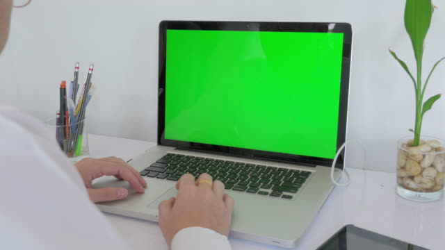Businessman using on computer laptop with green screen,Dolly shot video