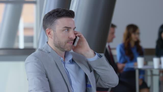 Businessman using phone video