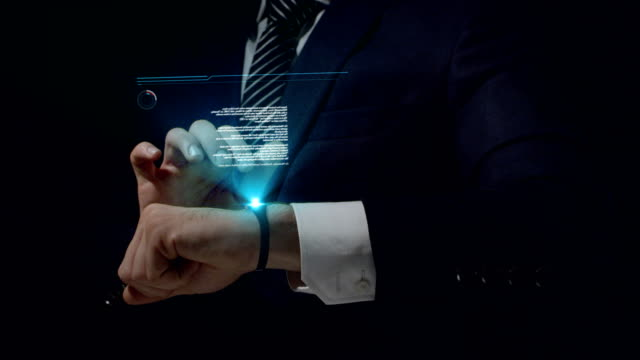 businessman using smartwatch. touching holographic screen - computer indossabile video stock e b–roll